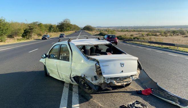 Accident rutier pe DN39. O maşină s-a răsturnat pe partea carosabilă - 2-1600190324.jpg