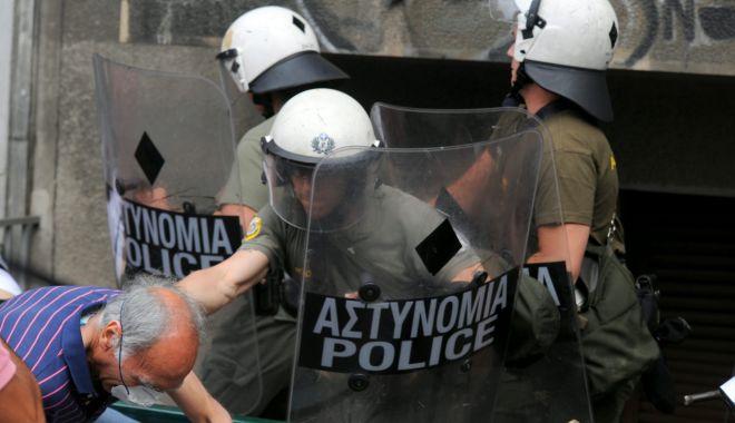 Grecii au protestat împotriva măsurilor guvernamentale pentru a combate răspândirea variantei Delta a coronavirusului - greciaprotestescaled-1626321035.jpg