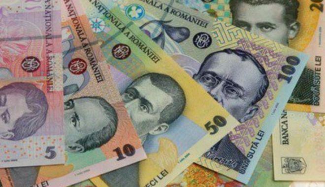 Foto: Leul cedează în fața euro și francului elvețian, dar mușcă din dolar