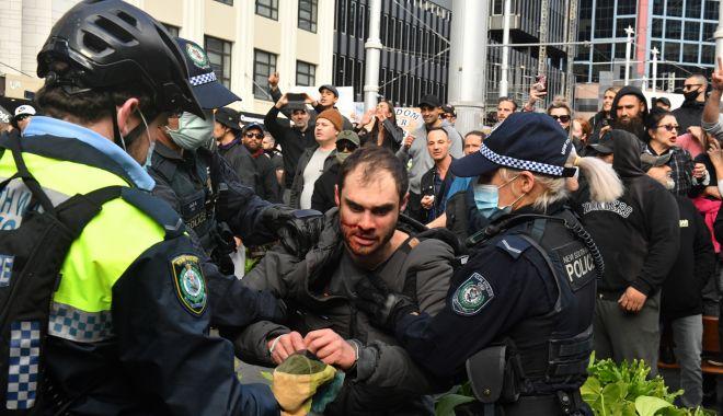 Proteste violente în Australia, din cauza restricțiilor Covid-19 - proteste-1627123515.jpg