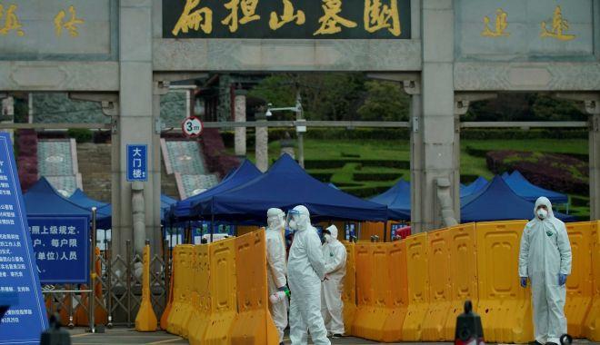 Echipa internațională de cercetători OMS a ajuns la Wuhan pentru a investiga originea coronavirusului - wuhan-1610608784.jpg