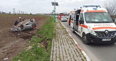 FOTO/VIDEO. Mașină răsturnată, la Lumina. O victimă dusă la spital