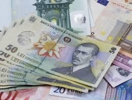 Leul cedează la euro și dolar, dar câștigă la francul elvețian